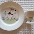 Hand painted Royal Doulton plate featuring dog and egg cup with dog