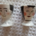 Hand painted porcelain pair girl and boy egg cups