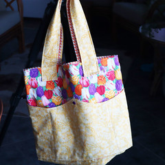Tote with wave pockets with plenty of room for an outing!