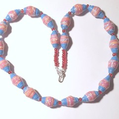 Paper bead necklace in pink and blue with red glass beads.