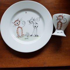Hand painted bone china Royal Doulton plate featuring cats with matching egg cup