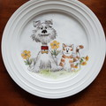Hand painted bone china plate featuring dog and cat