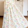 306 Hand-smocked organic cotton sleeveless dress, age 8, multicoloured wheels