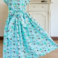 316 Hand-smocked cotton dress, age 5 to 6, aqua print of mermaids and whales