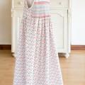 349 Hand-smocked cotton sleeveless dress, age 6 to 7, multicoloured paw prints