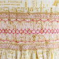 312 Hand-smocked cotton dress, age 4 to 5, Paris-themed print in gold
