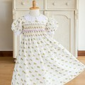 339 Hand-smocked off-white cotton dress for age 3 to 4, with gold unicorns