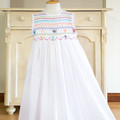 276 Hand-smocked white embroidered cotton sleeveless dress, age 6 to 7
