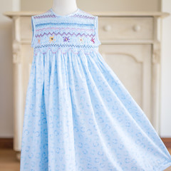 269 Hand-smocked blue cotton sleeveless dress, age 5-6, footprints print