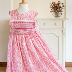 355 Hand-smocked cotton dress, age 6 to 7, detailed floral print in red and pink