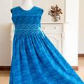 343 Hand-smocked cotton sleeveless dress for age 8 to 9, wrap-around skirt