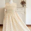 347 Hand-smocked cotton sleeveless dress for age 9, wrap-around skirt