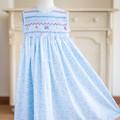 269 Hand-smocked blue cotton sleeveless dress, age 5-6, footprints print