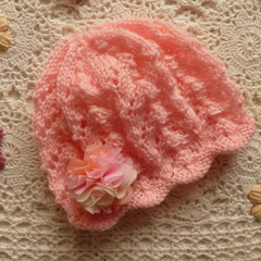 Baby girl's lacy beanie with rosette hairclip; fits up to 9 months;  5-ply wool