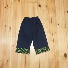 Little Hipster Pants with cuff. Cuff in black with green flame print