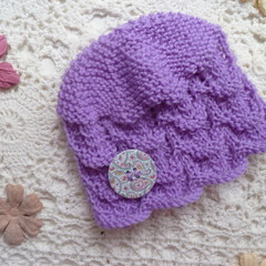 Hand-knitted baby girl's lacy beanie w button; fits NB; 4-ply Australian wool