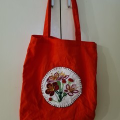 Red tote bag with embroidered pink and red flowers