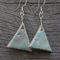 Unique handmade ceramic earrings. Great gift idea. Pastel blue triangles.