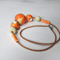 Necklace - Orange Zest- NMS2. Pottery, hand-painted wood, leather cord.