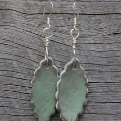 Unique handmade ceramic earrings. Earthy green leaves.