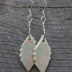 Unique handmade ceramic earrings. Abstract orange and blue.