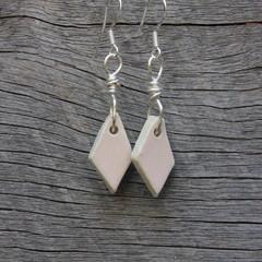 Unique handmade ceramic earrings. Pastel pink diamonds