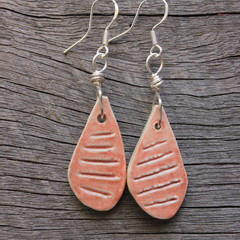 Unique handmade ceramic earrings. Coral orange drops.