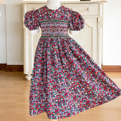382 Hand-smocked cotton dress, age 3 to 4, multicoloured flowers on black