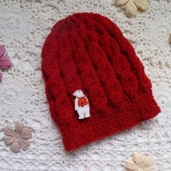 Baby's hand-knitted cable-knit beanie with button to fit 3 - 6 mths; 4-ply wool