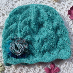 Baby girl's lacy beanie with chiffon flower; fits 9 - 18 months;  8-ply wool