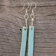Unique handmade ceramic earrings in pastel blue. Great gift idea.