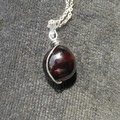 Garnet gemstone pendant, sterling silver wire wrapped