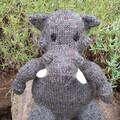 Warthog hand knitted soft toy. Child, baby gift.  African animal softie.