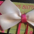 White bow with dangling Ballerina charms