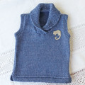 Hand knitted woollen vest size 00. Possum applique