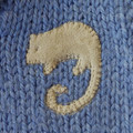AUTUMN SALE:  Hand knitted woollen vest size 00. Possum applique