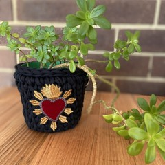 Crochet basket with embroidered patch.