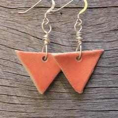 Unique handmade ceramic earrings. Coral orange triangles.