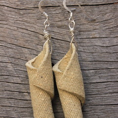 Unique handmade ceramic earrings. Great gift idea.Raw clay wraps.