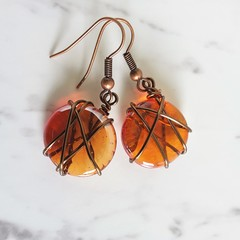 Antique boho style Round Red orange glass disk wire wrapped dangle earrings