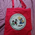 Bright red tote bag with little girl and strawberries