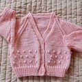 Size 6-12 months: Girls cardigan in Coral colour
