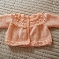 SIZE 0-6 mths - Hand knitted baby cardigan/jacket in apricot by cuddlecorner