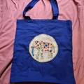 Blue tote bag with elephant embroidery