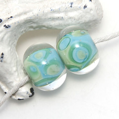 Encased Spotty Blue and Green Lampwork Glass Bead Pair
