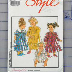 Style 2014 girls dresses pattern. Size 3m - 36m. Uncut pattern.