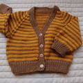 Size 3-9 months: boy, cardigan in burnt  orange and brown, easy care, washable