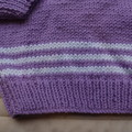 Size 6-12 months hand knitted jumper; purple and white, girl, washable,