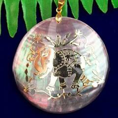 Abalone and gold elephant pendant .