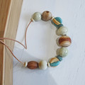 Earthly Harmony - N325W. Necklace hand-carved wood and pottery.